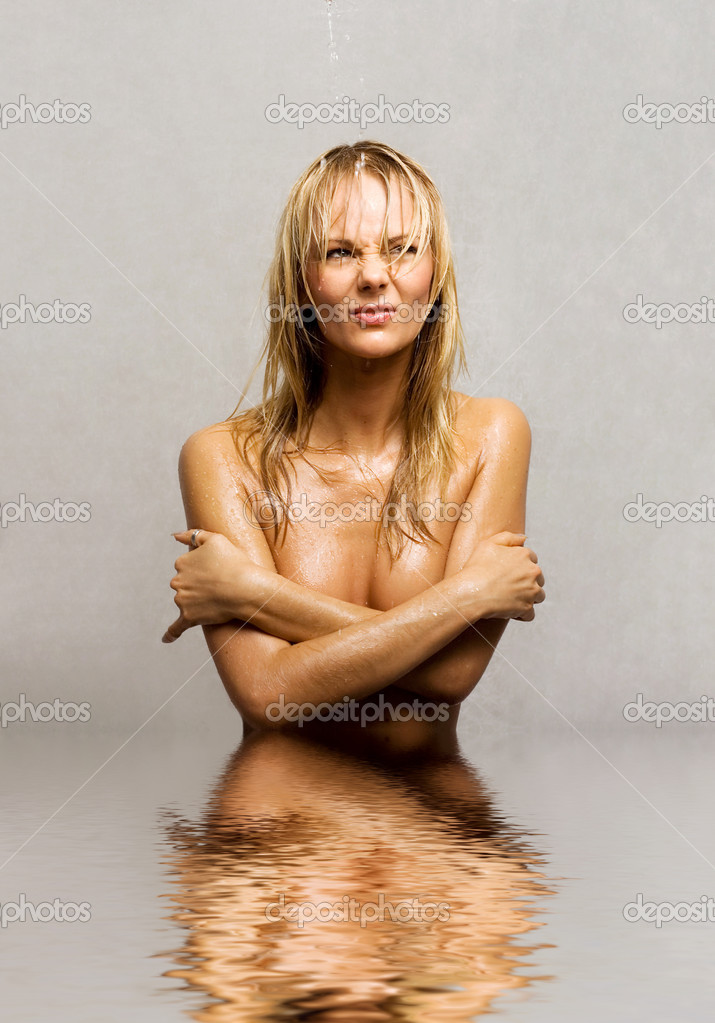 Picture of wet topless girl standing in water — Stock Photo #11757115