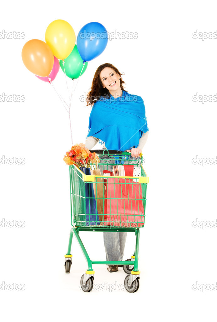 Happy woman with shopping cart and balloons over white — Stock Photo #11757362