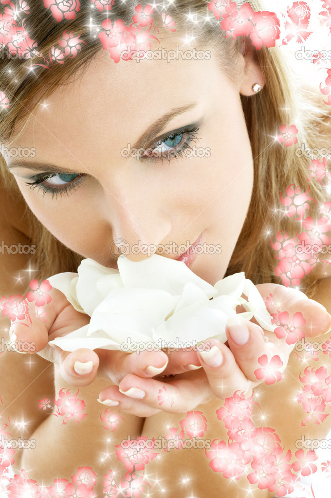 Lovely woman in spa smelling white rose petals surrounded by rendered flowers — Stock Photo #11757398