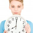 Woman holding big clock — Stock Photo #11760058