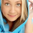 Portrait of smiling blond in blue scarf - Foto Stock