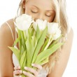Lovely blond with white tulips — Stock Photo #11761065