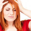 Unhappy redhead woman — Stock fotografie #11761359