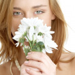 Girl with white chrysanthemum — Stock Photo
