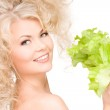 Happy woman with lettuce — Stock Photo #11761406