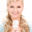 Woman holding energy saving bulb — Stock Photo #11761472
