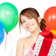 Party girl with balloons and gift box — Foto Stock