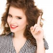 Teenage girl with her finger up — Stock Photo