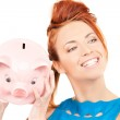 Lovely woman with piggy bank — Stock Photo #11762155