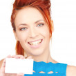 Happy girl with business card — Stock Photo #11762265