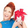 Happy girl with gift box — Stock Photo #11762453