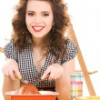Stock fotografie: Young attractive womin kitchen