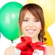 Party girl with balloons and gift box — 图库照片 #11762740