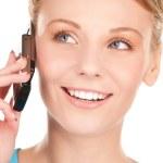 Happy businesswoman with phone — Stock Photo