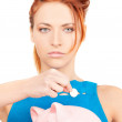 Lovely woman with piggy bank — Stock Photo #11763168