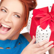 Happy girl with gift box — Stock Photo #11763391