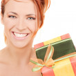 Happy girl with gift box — Stock Photo #11763567