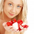 Happy blond in spa with red and white rose petals — Stock Photo #11763639