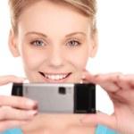 Happy woman using phone camera — Stock Photo