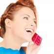 Happy woman with pink phone — Stock Photo #11763721