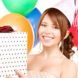 Party girl with balloons and gift box — Stock Photo #11763876