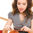 Young attractive woman in the kitchen — Stock Photo #11763878
