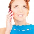 Happy woman with pink phone — Stock Photo #11763887