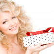 Happy girl with gift box — Stock Photo #11763915