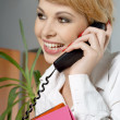 Office lady with folders making phone call — Stock Photo #11763974