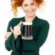 Redhead in green dress with a mug of irish stout beer — Stock Photo