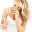 Happy teenage girl with a white phone — Stock Photo #11764183