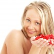 Lovely blond in spa with red and white rose petals — Stock Photo