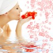 Red petals and flowers in water - Stock Photo
