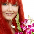 Lovely redhead with orchid - 图库照片
