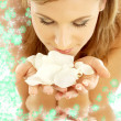Smelling rose petals in water with flowers - Stock Photo