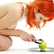 Naked redhead with green apple on vinyl record — Stock Photo #11764547