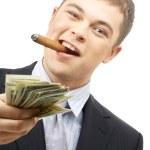 Smoking gangster holding dollar bills — Stock Photo