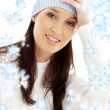 Stock Photo: Lovely brunette in winter hat with snowflakes