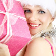 Santa helper girl with pink gift box - 图库照片