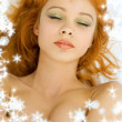 Dreaming redhead with snowflakes - Stock Photo