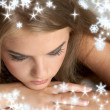 Thoughtful girl with snowflakes - Stock Photo