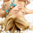 Dreaming blond in bed with snowflakes — Stock Photo
