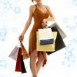 Shopping redhead with snowflakes - Stockfoto