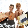 Shopping girls with snowflakes — Stock Photo