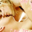 Couple foreplay with flowers — Stock Photo