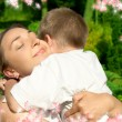 Stock Photo: Happy mother and son with flowers