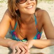 Smiling bikini girl on sand — Stock Photo #11765981