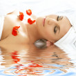 Red petals spa with water — Stock Photo #11766032