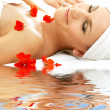 Red petals spa with water — Stock Photo #11766035