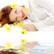 Beauty with yellow flowers on white sand — Stock Photo